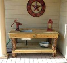 galvantized sink cute idea for potting table.. Tree legs...