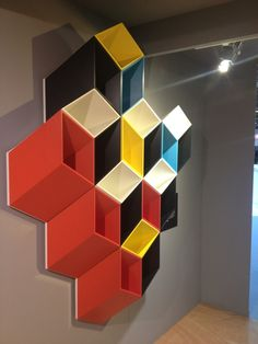 These optical-illusion geometric, modular shelving units are a fantastic way to create a statement on your wall