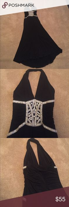 Long black gown size 4 with beautiful beading Long black gown size 4 with beautiful beading along the front. The brand is called Jessica mc clintock. Not Chanel Versace Bebe guess bcbg. Perfect for a formal event prom winter formal homecoming and such. Dresses