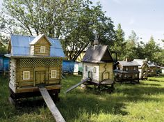 Miniature village of beehives...my grandpa used to keep bees and I remember eating fresh honey and the funny screened hat, screen veil and gloves he wore.