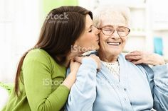 Granddaughter kissing her grandmother royalty-free stock photo
