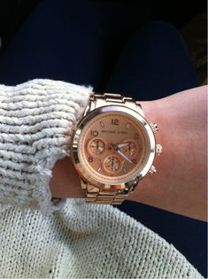 Michael Kors Rose Gold Watch, same one my boyfriend bought me. :)