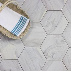 Artisan Wood Hexagon x Ceramic Wood Look Tile in White are carefully crafted with the appearance of hardwood tiles, while keeping the sturdy, easy to care for nature of ceramic tile. Hardwood Tile, Best Floor Tiles, Kitchen Chandelier, Wood Look Tile, Hexagon Tiles, Modern Shower, White Oak, Kitchen Flooring, Decorative Objects