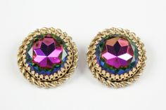 "Vintage signed, Elsa Schiaparelli watermelon button earrings. These earrings have a beautiful bezel set watermelon stone that measures approximately 1"". This style, due to the size, is also known as a headlight setting. The earrings measures 1.25"" and are in good condition with the only signs of obvious wear to the finish on the reverse side. Schiaparelli jewelry is a prized possession in any vintage jewelry collection."
