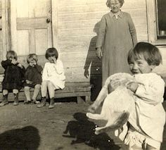 Taloga, Oklahoma c.1930 - A Grandmother and her grandchildren...They never knew how poor they were.