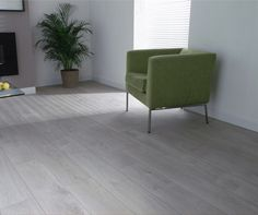 Our Engelberg Oak flooring creates a very airy effect in this minimal living room. Flooring, Best Laminate, Oak Laminate Flooring, Interior Design, Living Area Design, White Floors, Furniture, Cool Rooms, Floor Design