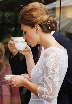 Catherine, Duchess of Cambridge drinks tea at the British High Commission in Kuala Lumpur, Malaysia. September, 2012