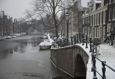 Snow-covered bridge spanning a canal in the center of Amsterdam, Netherlands, Monday Jan. 21, 2013.