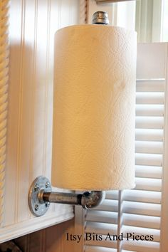 """ndustrial Paper Towel Holder. 1/2"""" cir at a length of 12"""" pipe, a length of 4"""" pipe, a 90 degree elbow, a 3"""" plate, a cap"""