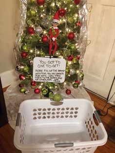 "Well isn't this a great idea! If you're going to do ""Elf on the Shelf,"" let him/her help you pare down your kids' toys. Excellent! Christmas Wreaths, Christmas Eve, Elf Christmas Decorations, Christmas Things To Do, Holiday Crafts, Christmas Gifts, Christmas Labels, Christmas Stuff, Holiday Ideas"