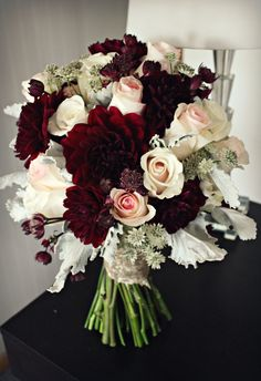 Blush, burgundy and champagne wedding. Burgundy dahlias, blush roses and ivory roses. Champagne sequin wrap.