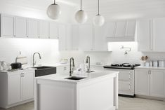 There's a reason why all-white kitchens are so popular. For this kitchen, we're loving iconic appliances, subway tile, and faucets with vintage design details mixed with soft-modern elements such as a farmhouse sink in a deep, contrasting color.
