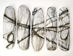 "brenda holzke; BARBED WIRE 19""X36""( five wall panels ) high fired stoneware"