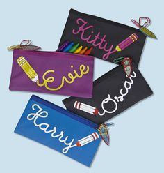 Purple, Black with pink writing, Black with white writing and Turquoise Standard Pencil Cases