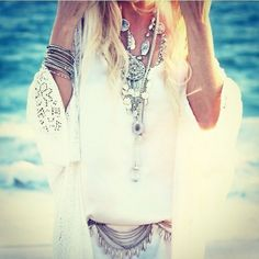 GYpsy style coin belt, modern hippie chic layered necklaces boho stacked silver bangles. For the BEST Bohemian fashion trends FOLLOW http://www.pinterest.com/happygolicky/the-best-boho-chic-fashion-bohemian-jewelry-gypsy-/ now