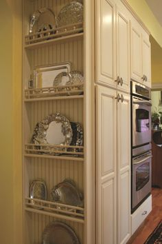 Another great use of space. This rack keeps platters near the ovens and island but doesn't get in the way of the kitchen's everyday work zones.