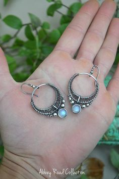 Large Boho Crescent Earrings// Rainbow Moonstone// Antique Silver These silver crescent earrings are the perfect accessory for any day! I love the way the cool silver wire pairs perfectly with the light blue sheen of the moonstones. -Moonstone is a reflective crystal and its