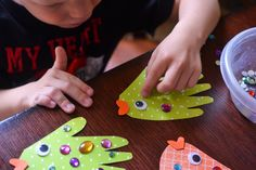 Whether you make them as a simple afternoon craft to pass the time or intend to use them as puppets like we did – these beautiful Handprint Fish Puppets are super easy, really inexpensive and of course – fun for ALL ages!