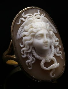An antique 'Medusa' shell cameo ring, Italian, 1860s. 22K gold, 9K gold and…