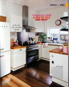this is exactly the kitchen i would like! white units with chrome handles/white metro tiles/wooden work tops and wood floor. We already have the chrome oven and Smeg!