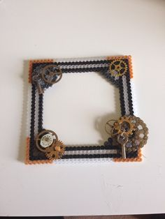 Black, clear, bronze, gold and silver Hama beads with various vintage clock parts and findings. Hama meets steampunk #teammerrily