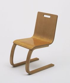 "Alvar Aalto. Child's Chair (model 103). 1931-32. Bent plywood and bent laminated birch, 23 3/4 x 13 5/8 x 16"" (60.4 x 34.6 x 40.6 cm), seat h. 11 7/8"" (30.2 cm). Manufactured by Oy Huonekalu-ja Rakennustyötehdas Ab, Turku, Finland. Gift of Artek-Pascoe, Inc."