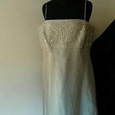 Shimmering floor length gown Seafoam color with silver embroidery topand clear gemstones. Michaelangelo Dresses Maxi