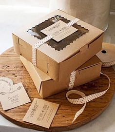 Package Christmas cookies in brown paper boxes and tie shut with ribbon for a cute homemade look. More ideas: http://www.midwestliving.com/homes/featured-homes/holiday-house-tour-tailor-made-holiday/?page=9,0