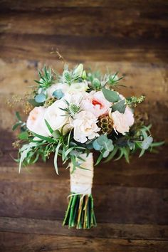 Small wedding bouquet with a blend of roses and peonies with silvery greenery