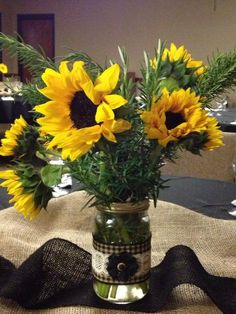 Mason jar and burlap center piece for wedding rehearsal dinner