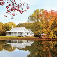 Farmhouse Fall - We Found the South's Best Fall Color - Southernliving. A farmhouse on a lake in Mathews, Alabama is aglow with the colors of the season.