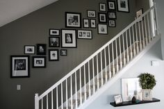 Pictures on Stairs like this with white and metallic frames