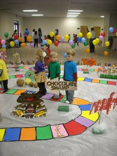 Candyland-big dice with colored sides; colored squares for children to walk on (create a pathway); language pictures on various squares; castle picture as the final square