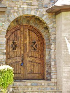 Wood arch front entrance door creates a power statement. http://www.porterproperties.com/homes/AL/AUBURN/36830/1740_ALEX_AV/17999440/index.html