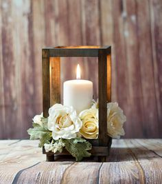 Reclaimed Wood Lantern *Please note: Listing is for Lantern Only - Candles/Flowers NOT included. Approx Measurements: Outside: 6 wide x 10.5 Tall Inside: 4.5 wide by 9 Tall Will hold Pillar Candles, 3-Wick Candles, and Mason Jars (candles not included) This item is made from reclaimed