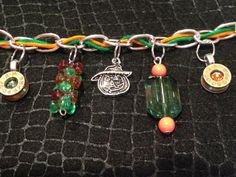 Halloween Bracelet made of pumpkin charms! It also has two bullet charms - one set with a green Swaroski Crystal, and one in orange.