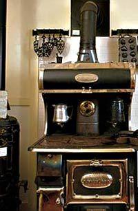 An antique cast iron coffee grinder.