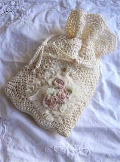 Pretty little crocheted bag with ribbon embroidery embellishment by Zuzu at A Cottage In The Woods.