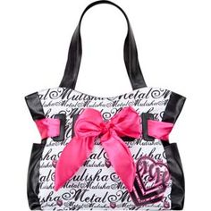 "Metal Mulisha Cruz In tote bag. Allover repeating Metal Mulisha script with large bow on front and faux leather trim. Slip pockets on sides. Magnetic snap close compartment offers interior zip pocket and organizer pockets. Approx dimensions: 12"" x 16"" x 7""(30cm x 40cm x 18cm). Imported.$37.99"
