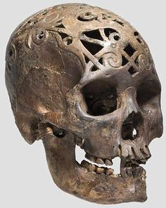 Dayak skull from Borneo, carved in pierced relief. Some Dayak tribes practised head hunting, i.e. the head of the defeated enemy was considered as proof of masculinity of the winner and forced the soul of the loser to serve the conqueror in the afterlife. Gruesome but every explorer should have been to Borneo.