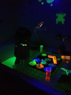 A kids glow bath - with highlighter pen water and shaving foam paint!