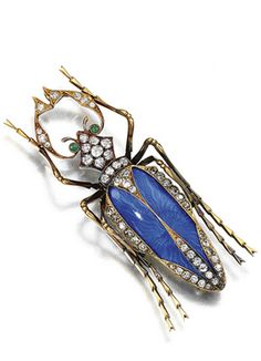 ENAMEL, EMERALD AND DIAMOND BROOCH, RUSSIAN, CIRCA 1910 Designed as a beetle, the body decorated with royal blue guilloché enamel, circular-cut emerald eyes, highlighted with circular- and single-cut diamonds, 56 Zolotnik mark, St Petersburg 1908-1917, workmaster's mark, fitted case.