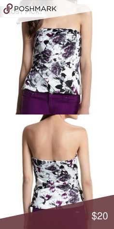 """WHBM purple white pleated floral strapless bustier WHBM purple white pleated floral bustier, excellent condition. Strapless bustier, straight across neckline. Full side zip for easy in and out. Colors are gorgeous! Light boning for support, Pleated overlay crossover wrap. Pit to pit 15"""", length is about 15"""". White House Black Market Tops Blouses"""