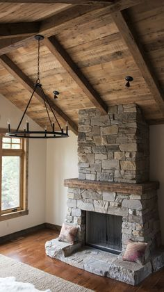 Can you catch all of the reclaimed material we provided in this one photo alone? Flooring, trim, mantel, ceiling beams, and paneling. Neutral rugs and patterned pillows are the perfect accents for this space.