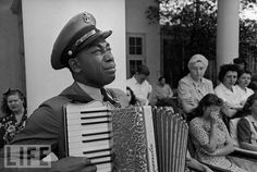 """Goin' Home: Photo by Ed Clark, 1945  Navy Chief Petty Officer Graham Jackson had played the accordion often for Franklin D. Roosevelt during the polio-stricken president's frequent visits to the spa at Warm Springs, Ga. He was scheduled to play for him again on April 12, 1945, the day Roosevelt died at the LIttle White House in Warm Springs. Instead, the officer found himself leading the funeral procession the next day, tears streaming down his face while he played such mournful dirges as """"Goin' Home"""" and """"Nearer My God to Thee."""""""