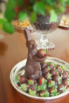 a chocolate bunny becomes the host of dipped strawberries: Easter table inspiration