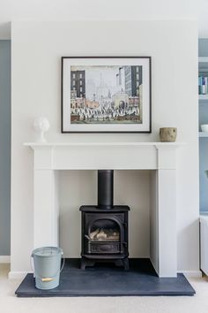 Chesney's contemporary gas stove, slate hearth, Lowry print. Wood Burner Fireplace, Fireplace Hearth, Home Fireplace, Living Room With Fireplace, Fireplace Surrounds, New Living Room, Interior Design Living Room, Living Room Designs, Living Room Decor