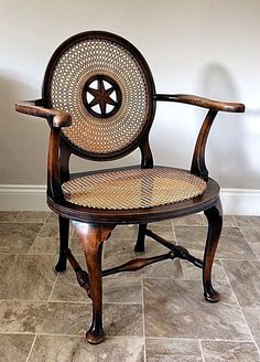 Antique Stained Beech Framed Elbow Chair with Cane Seat & Wheel Back