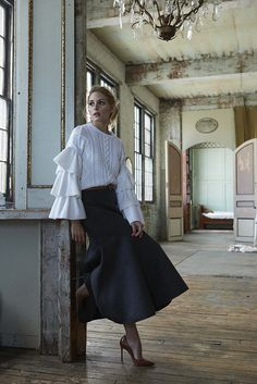 Wearing a Valentino sweater, Michael Kors skirt, and belt. Image Source: Courtesy of Holt Renfrew/HoltRenfr...