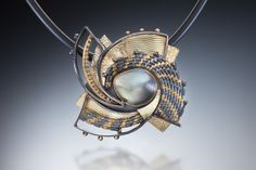 Handwoven and fabricated 22k, 18k, oxidized sterling and fine silvers.